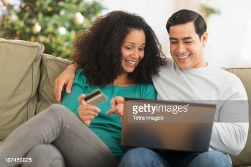 USA, New Jersey, Jersey City, Couple using laptop for online shopping : Stock Photo
