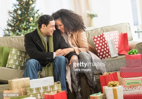 USA, New Jersey, Jersey City, Couple with Christmas presents in living room : Stock Photo