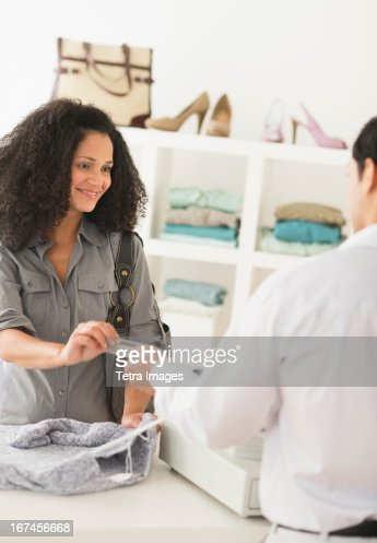 USA, New Jersey, Jersey City, Customer and sales clerk in store : Stock Photo