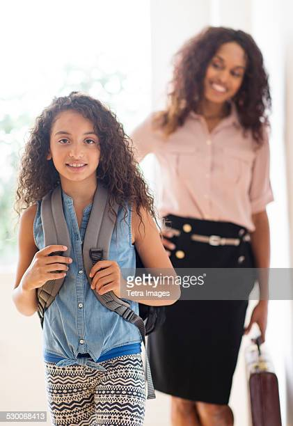 USA, New Jersey, Jersey City, Daughter (8-9) and mother going to school