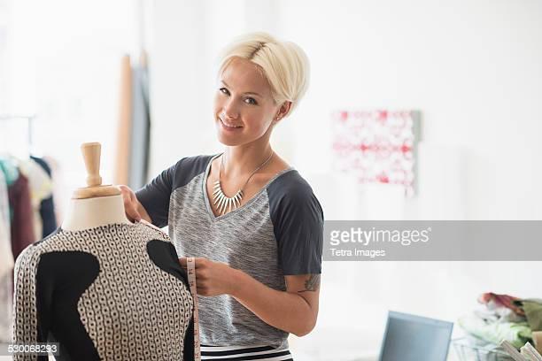 USA, New Jersey, Jersey City, Designer creating dress