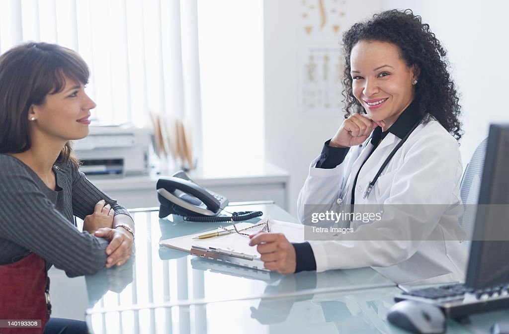 USA, New Jersey, Jersey City, Doctor with patient in office : Stock Photo