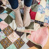 USA, New Jersey, Jersey City, Elevated view of woman's legs wearing woolen socks