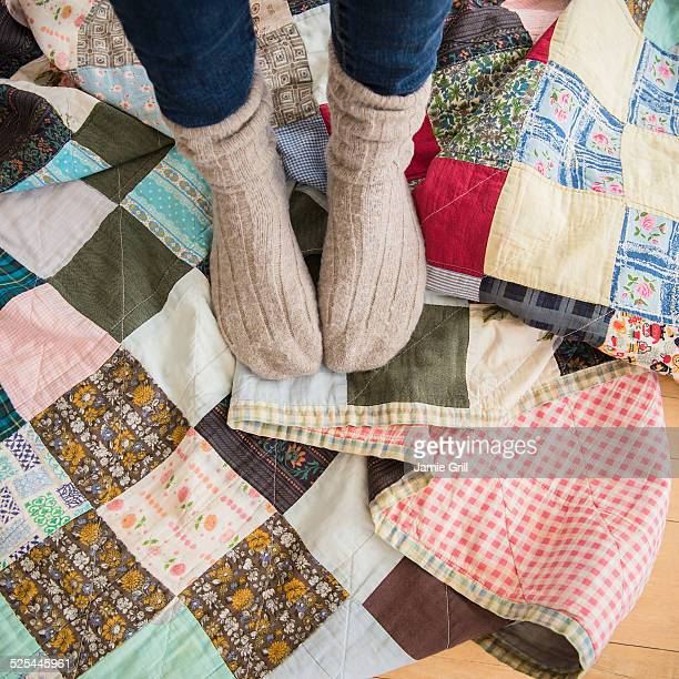 USA, New Jersey, Jersey City, Elevated view of woman's legs wearing woolen socks
