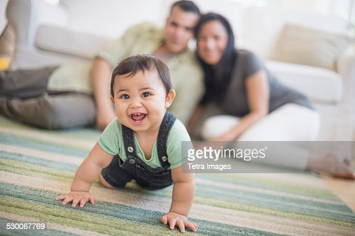USA, New Jersey, Jersey City, Family with baby son (6-11 months) in living room