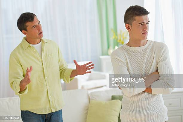USA, New Jersey, Jersey City, Father and son (16-17) arguing