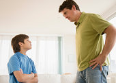 USA, New Jersey, Jersey City, Father and son (8-9) arguing