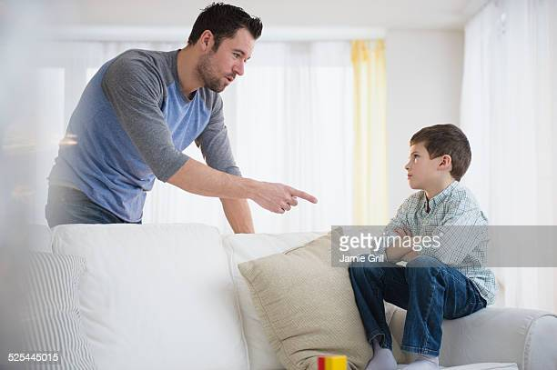 USA, New Jersey, Jersey City, Father disciplining son (8-9)