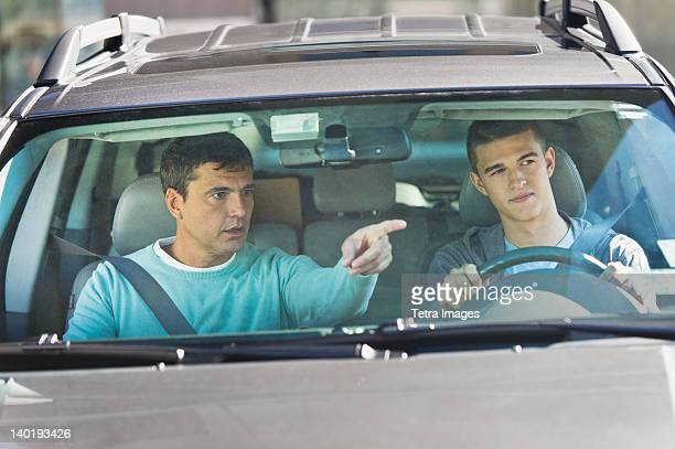 USA, New Jersey, Jersey City, Father with teenage (16-17) son driving