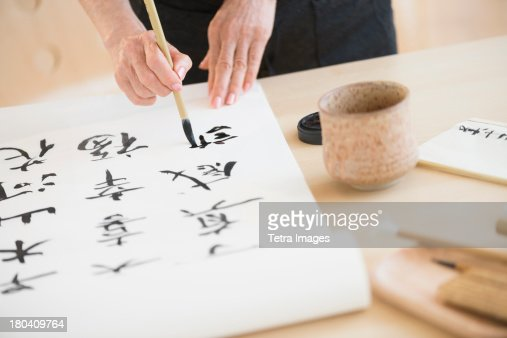 USA, New Jersey, Jersey City, Female hands and japanese calligraphy