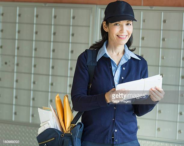 USA, New Jersey, Jersey City, Female postal worker holding letter