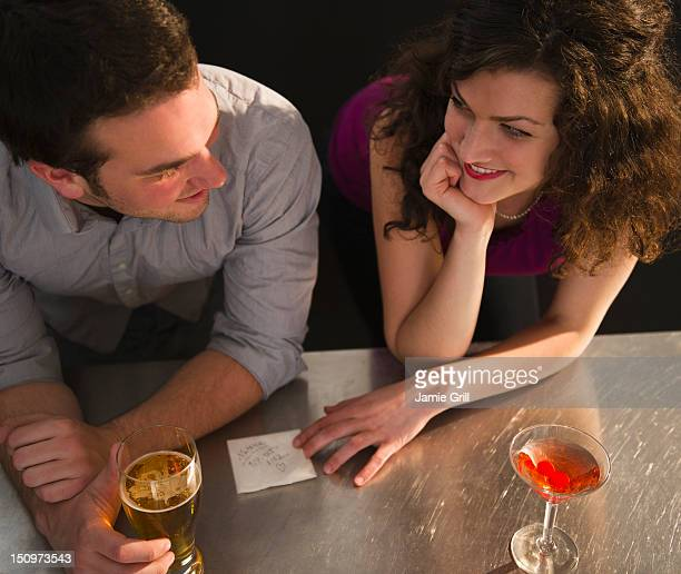 USA, New Jersey, Jersey City, Flirting couple sitting at bar counter