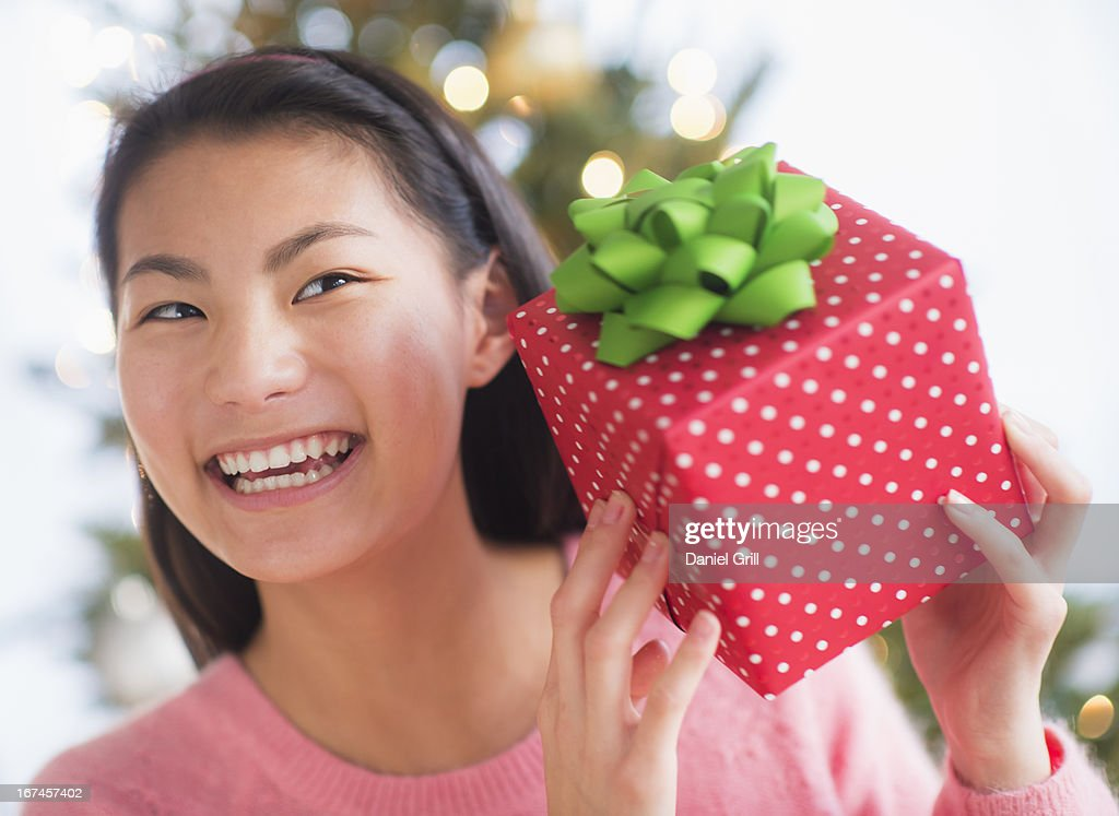 USA, New Jersey, Jersey City, Front view of teenage girl ( 16-17 years) holding Christmas gift : Stock Photo