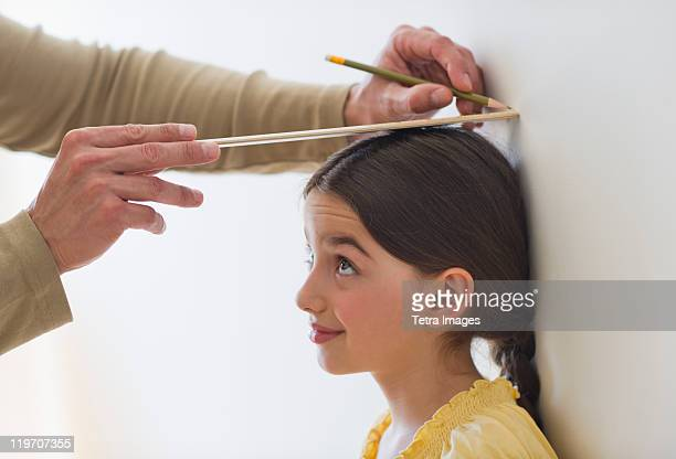 USA, New Jersey, Jersey City, girl (8-9) being measured