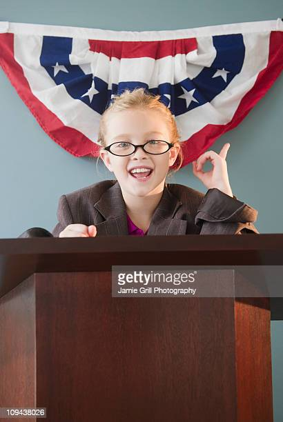 USA, New Jersey, Jersey City, Girl (8-9) giving speech from pulpit