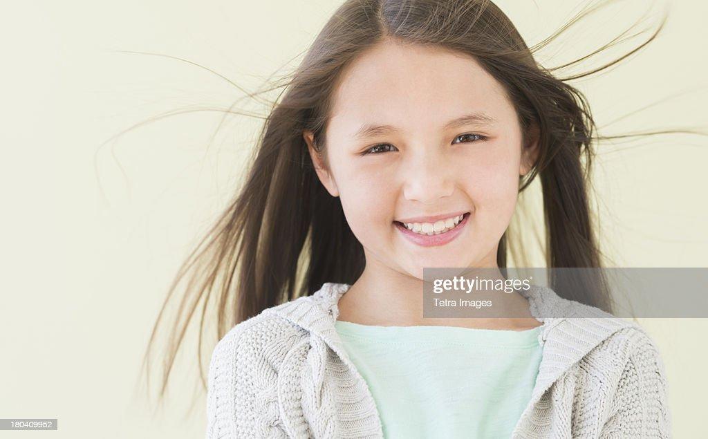 USA, New Jersey, Jersey City, Girl (8-9) smiling, portrait : Stock Photo