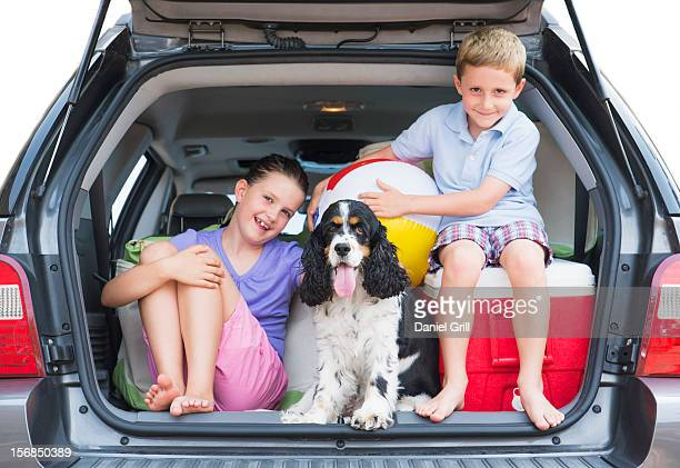 USA, New Jersey, Jersey City, Girl (8-9) together with her brother (6-7) and their do setting out for vacations