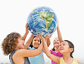 USA, New Jersey, Jersey City, Girls (6-9) holding globe