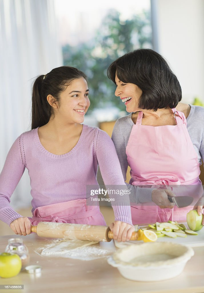 USA, New Jersey, Jersey City, Grandmother and granddaughter (16-17) baking together : Stock Photo