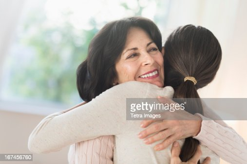 USA, New Jersey, Jersey City, Grandmother and granddaughter (16-17) embracing : Stock Photo