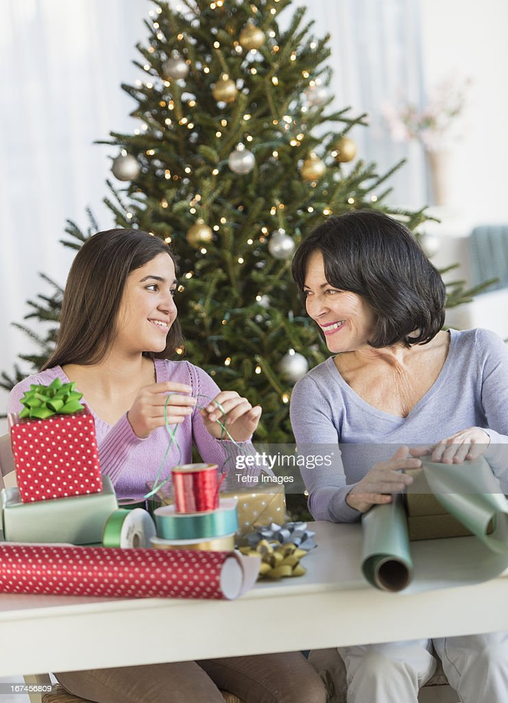 USA, New Jersey, Jersey City, Grandmother and granddaughter (16-17) wrapping christmas gifts : Stock Photo