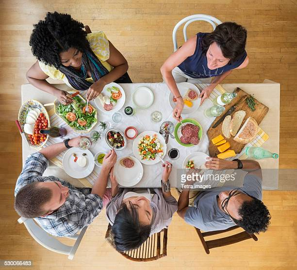 USA, New Jersey, Jersey City, Group of friends dining together