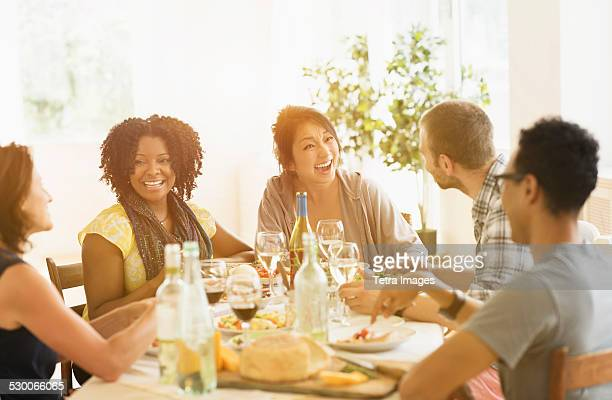 USA, New Jersey, Jersey City, Group of friends enjoying dinner party