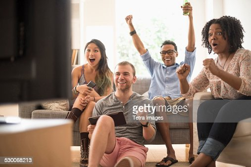 USA, New Jersey, Jersey City, Group of friends watching television