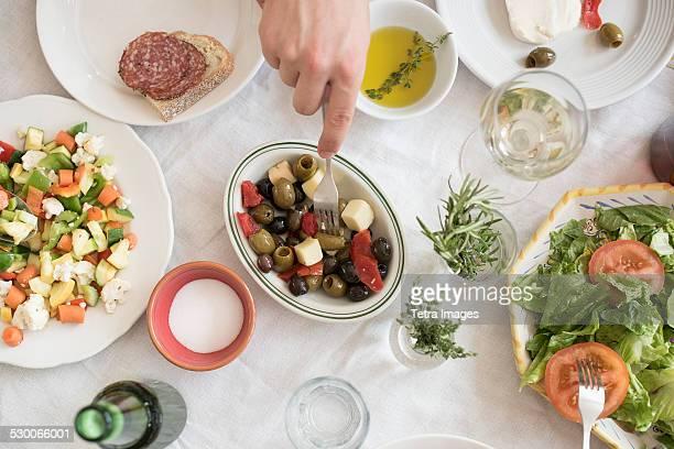 USA, New Jersey, Jersey City, Hand serving salad
