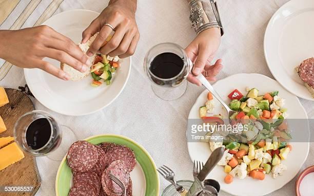 USA, New Jersey, Jersey City, Hands serving salad