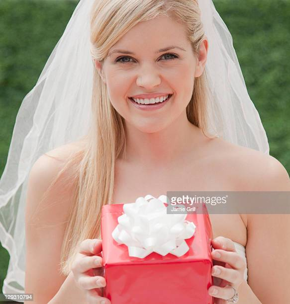 USA, New Jersey, Jersey City, Happy bride holding red box
