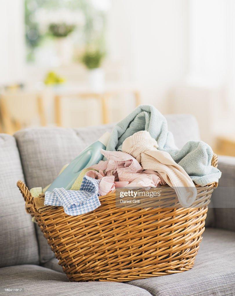 USA, New Jersey, Jersey City, Laundry basket on sofa