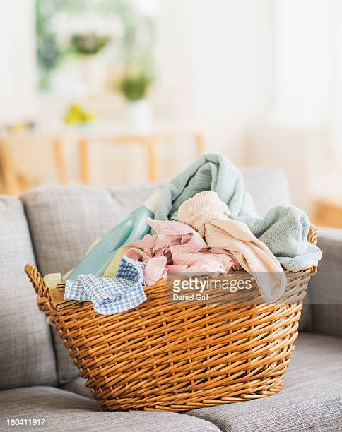 USA, New Jersey, Jersey City, Laundry basket on sofa