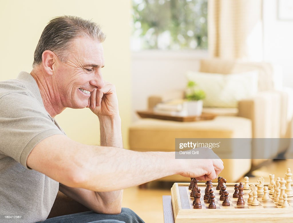 USA, New Jersey, Jersey City, Ma playing chess