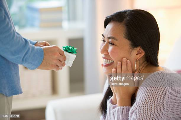 USA, New Jersey, Jersey City, Man giving to woman engagement ring