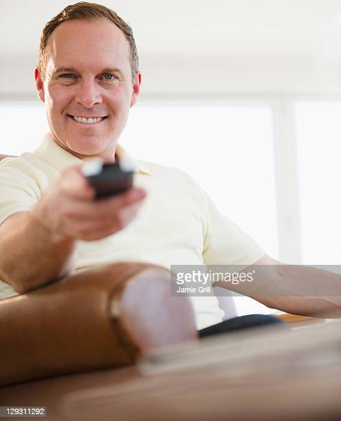 USA, New Jersey, Jersey City, Man holding remote control