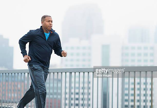 USA, New Jersey, Jersey City, Man running in city