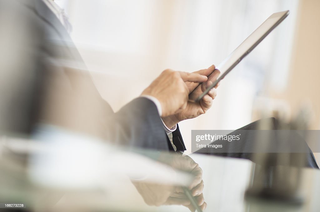 USA, New Jersey, Jersey City, Man using tablet pc : Stock Photo