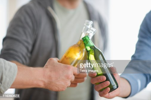 USA, New Jersey, Jersey City, men toasting with beer