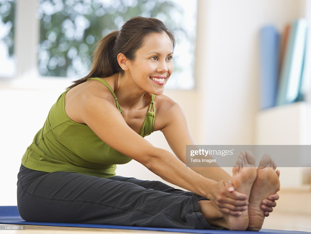 USA, New Jersey, Jersey City, Mid adult woman training with dumbbell