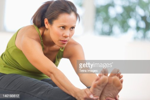 USA, New Jersey, Jersey City, Mid adult woman training with dumbbell : Stock Photo