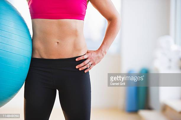 USA, New Jersey, Jersey City, midsection of woman holding fitness ball