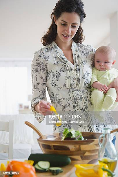 USA, New Jersey, Jersey City, Mother and baby boy (2-5 months) cooking together