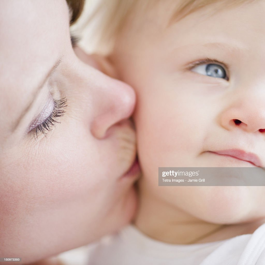 USA, New Jersey, Jersey City, Mother kissing son (6-11 months)