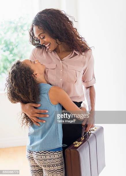 USA, New Jersey, Jersey City, Mother walking in home, daughter (8-9) welcoming her