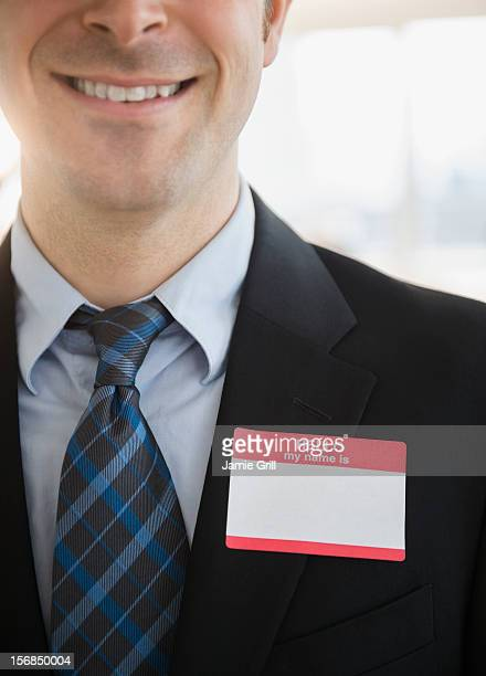USA, New Jersey, Jersey City, Office worker with name tag on suit
