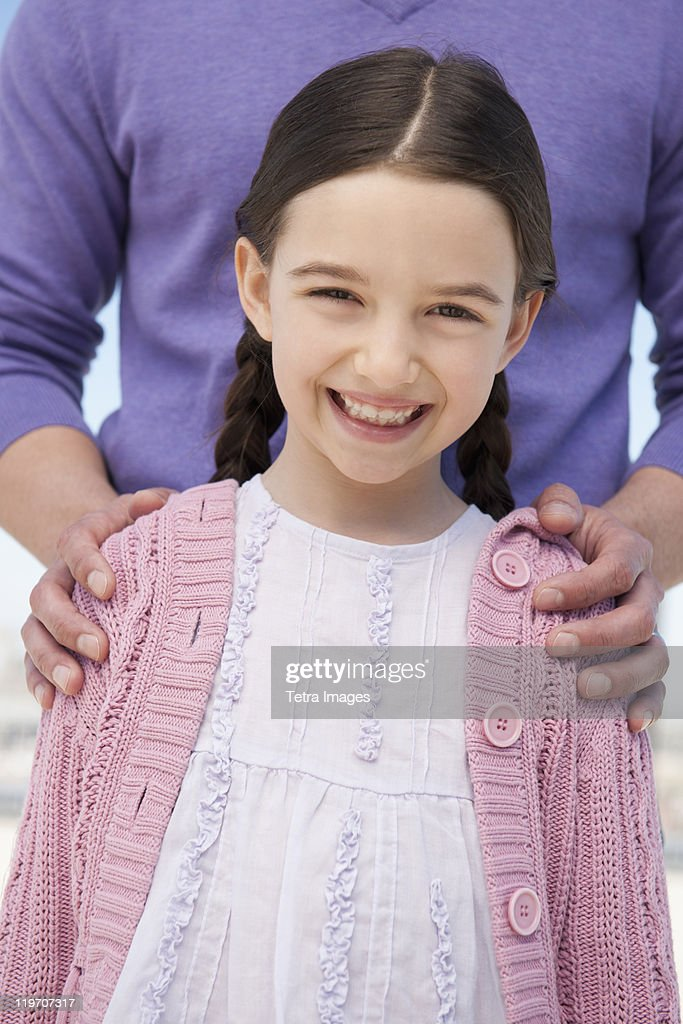 USA, New Jersey, Jersey City, portrait daughter (8-9) embraced by father : Stock Photo