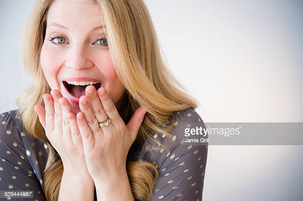 USA, New Jersey, Jersey City, Portrait of blond woman smiling