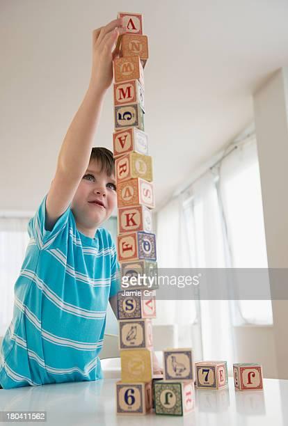 USA, New Jersey, Jersey City, Portrait of boy (4-5) building tower