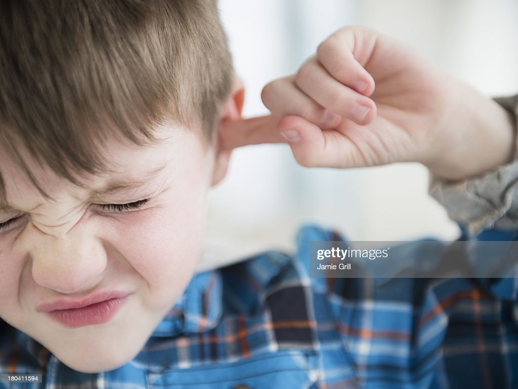 USA, New Jersey, Jersey City, Portrait of boy (4-5) sticking fingers in his ears